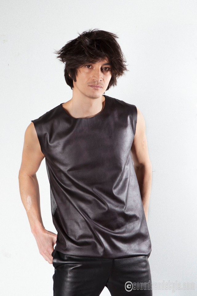 Nicolas Ly, Applause, lead-vocal:  fake leather and jersey T-shirt by Dominique Lila/ trousers: Jean-Paul Knott